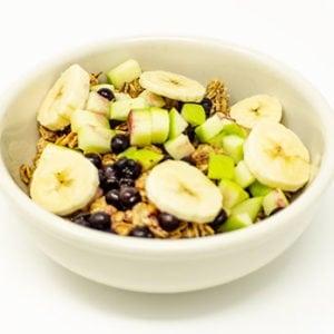 breakfast bowl of house toasted granola fresh fruit