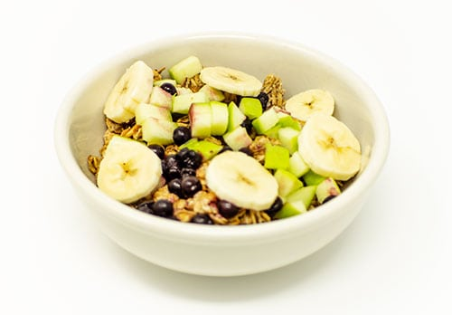 breakfast bowl of house toasted granola fresh fruit