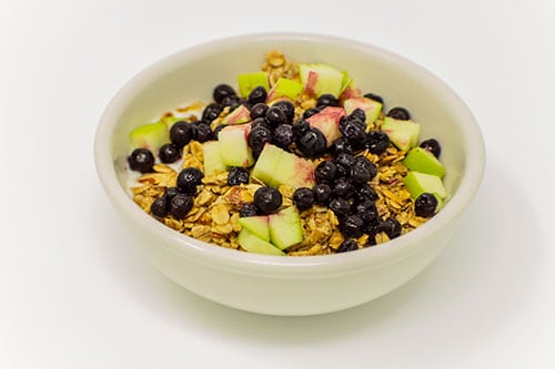 breakfast bowl of yogurt house toasted granola fresh fruit